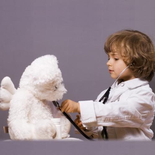 Kid and a teddybear