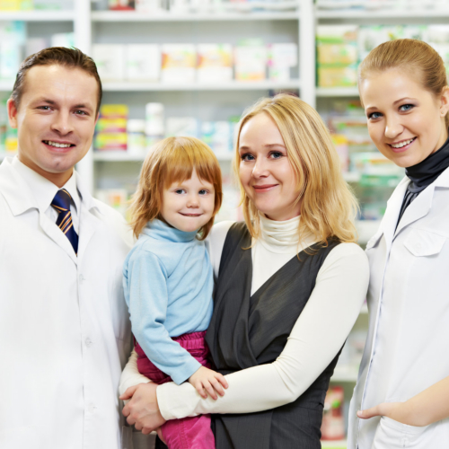 Male and Female pharmacist with a mother and child