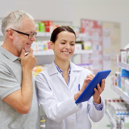 Female pharmacist and old male customer